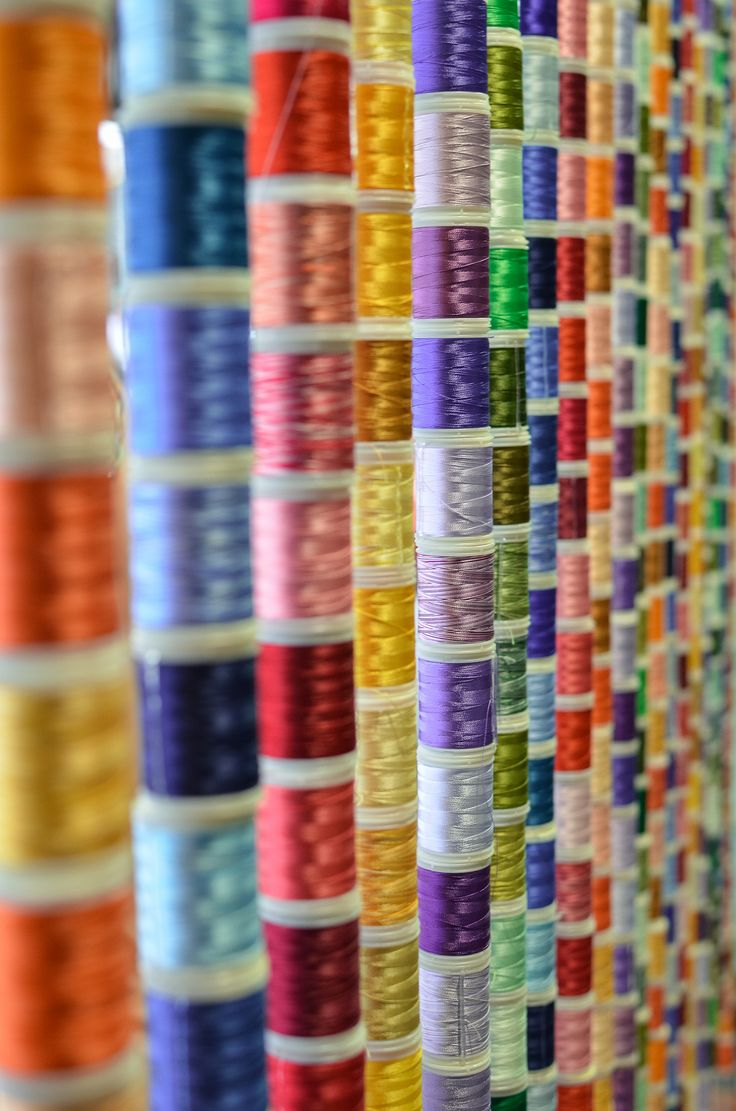 Interesting use of colourful cotton reels as a 'curtain'