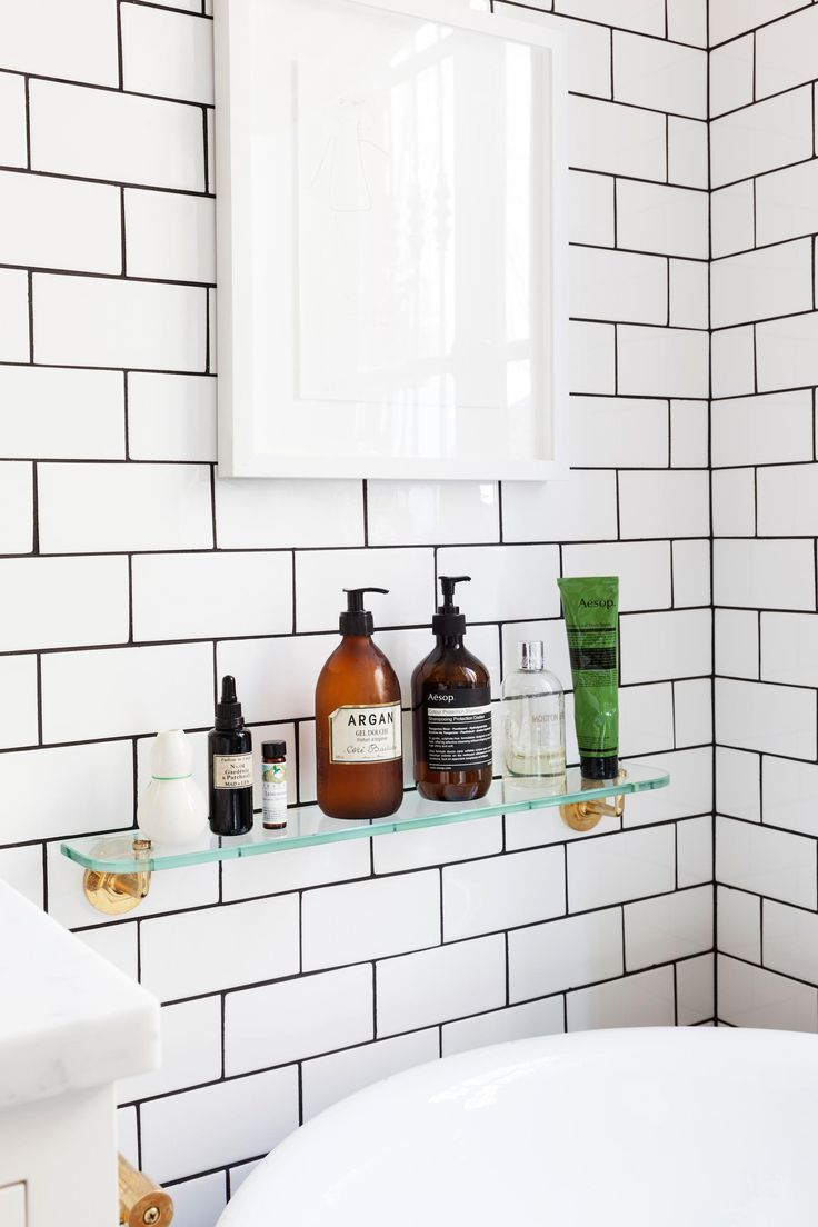 White tiles black grout bathroom - Access To Storage Space That Is Accessible From In The Bathtub Is Important