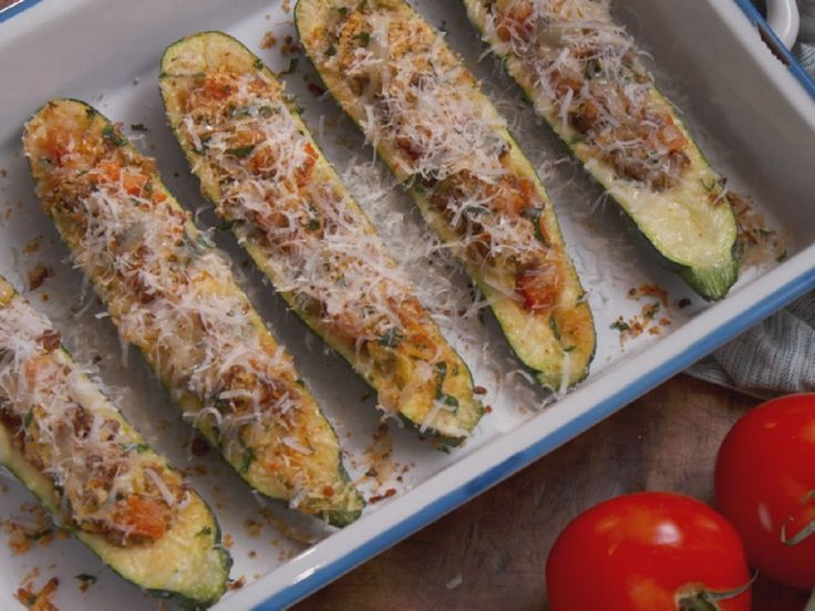 Sausage-Stuffed Zucchini Boats : Nancy combines equal parts of sweet and hot Italian sausage to form the meaty base of her veggie boats, built inside hollowed-out zucchini halves. Before baking, she dresses up the boats with an herbed two-cheese mixture for gooey results.