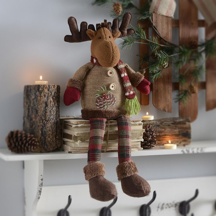 With his cozy mittens and scarf, our Rustic Reindeer Shelf Sitter is sure to brighten up your mantel or bookshelf. With red and green plaid accents, this festive little guy can sit just about anywhere.