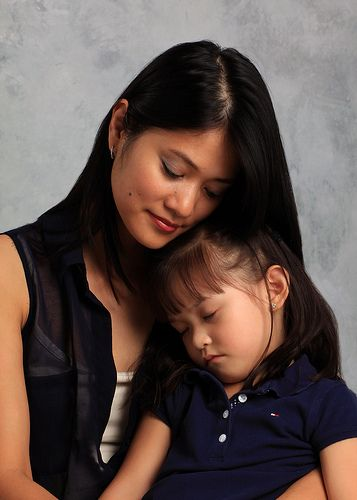 Mother and Sleeping Child.