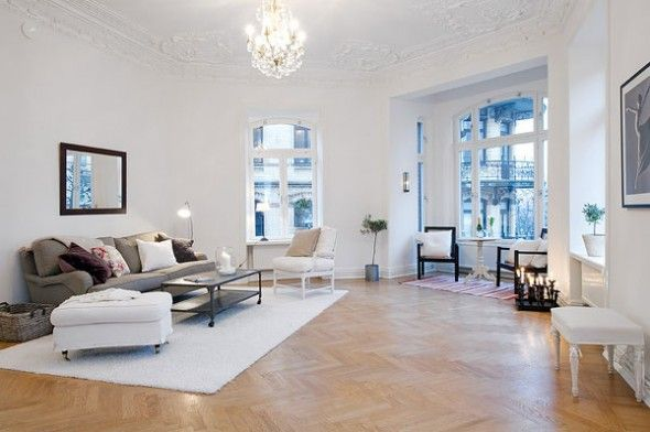 beautiful wide living room with white walls and ceillings interior