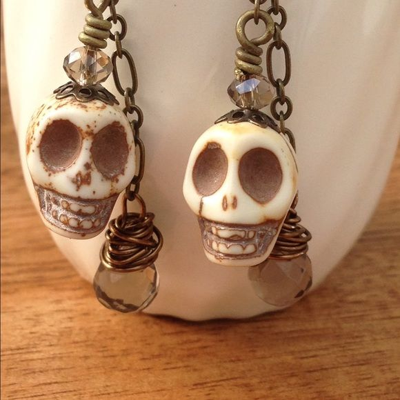 "Skull earrings Get ready to celebrate Dia de Los Muertos in style! Tear drop crystal wire wrapped with small crystal bead on skull head. Antique brass ear hooks. Measures approx 2"" from the ear hook. Handmade with lots of love by me❤️ Chula Art Jewelry Earrings"