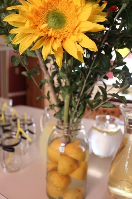 Sunflower centerpiece with cut lemons in mason jar