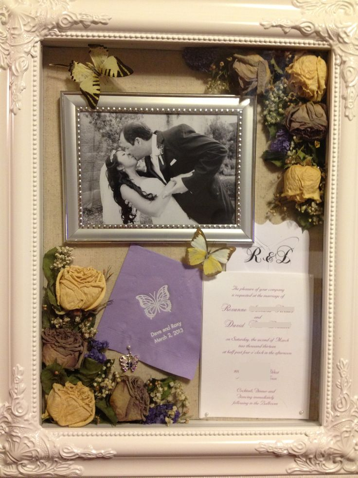 Wedding shadow box. $30 after coupon at Hobby Lobby. What's inside: my bouquet flowers, invite, program, napkin, cake server charm, frame from guest sign and table numbers. (We used butterfly species in lieu of table numbers)