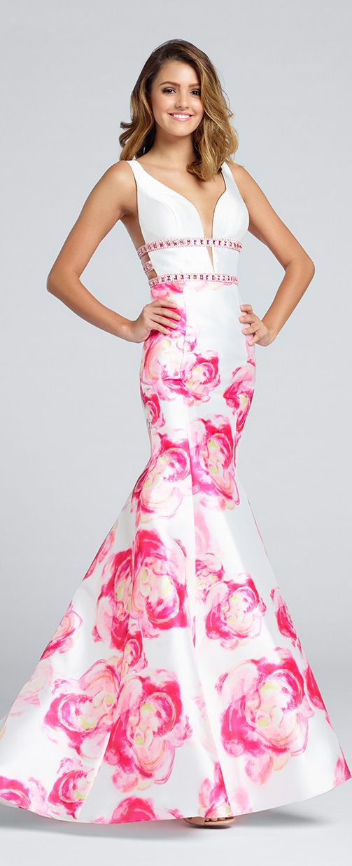 Sleeveless floral printed Mikado mermaid gown, plunging V-neckline with illusion modesty panel, hand-beaded bands, open midriff sides, open back, princess seamed skirt. Sister dress to style EW117028, EW117069 and EW117144.
