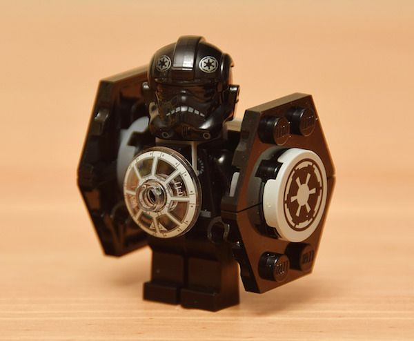 A Cute Collection Of Star Wars LEGO Minifigs Wearing Their Respective Ships