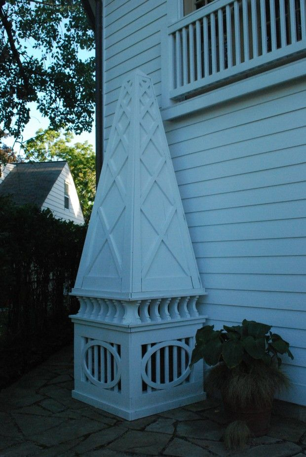 SO ATTRACTIVE!!! Wooden obelisk screening an air conditioner unit
