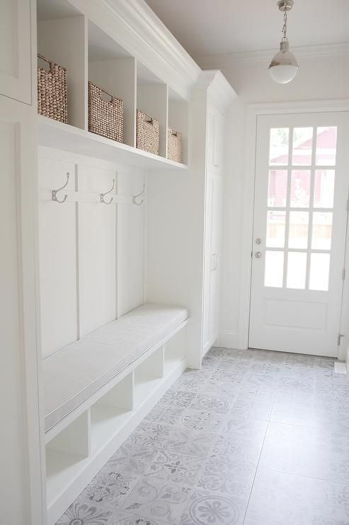 @JSHOMEDESIGN- Mudroom with built-in cabinets, bench seat with custom made cushion seat, restoration hardware hooks, patterned tiles
