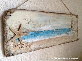 Una marina dipinta su una vecchia tavola tra Shabby e Vintage.