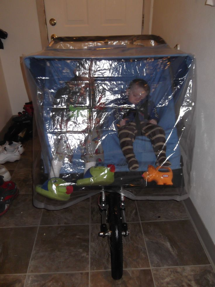 "DIY, cheap, stroller rain cover for $2! I couldn't find one in my price range so I bought a clear shower curtain  for $2 and sewed in in the shape of the stroller to slide over the top, front, and sides (4 straight, easy seams). Used a small piece of sticky Velcro to hold above the wheel and prevent wind/rain from getting my little guys. Photo is just back from evening run. Flash lights made it great fun. My son asks to ride in his ""bubble"" even when the weather is nice. Cheap, but works…"