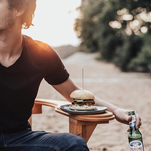 Him, a sunset, a good meal and a cold @peroni_ca. To me, that's the perfect evening. What's yours? #PeroniQC #MaisonPeroni #partner