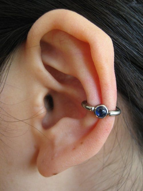 Conch ear piercing with eyeball diamond ring - More Gallery @ http://wp.me/p3zqJ1-s0