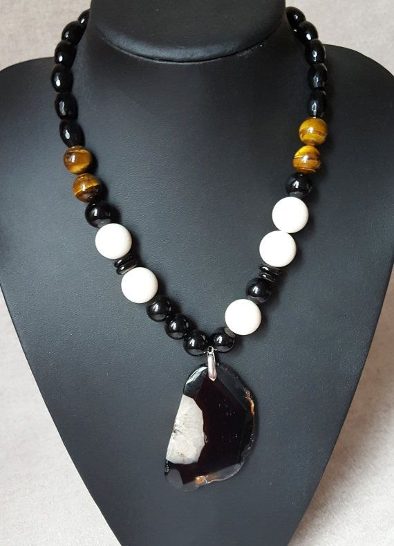 Big Round Sponge White Coral Bead Black Round Agate Round Tiger's Eye Big Black Agate Pendant Necklace Black Tube Chips Agate Earrings  https://www.instagram.com/abalone.abalone/