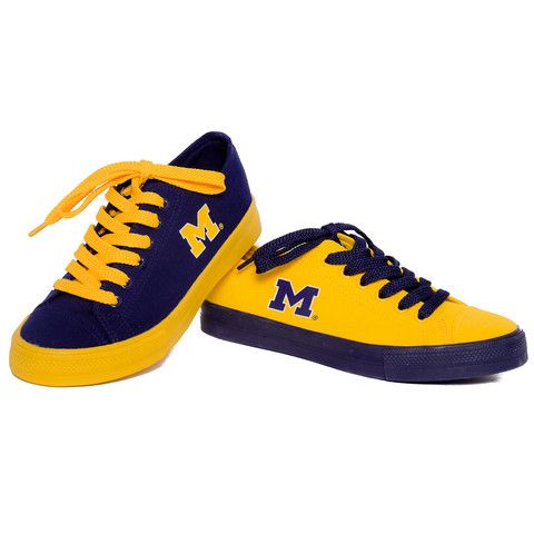 With a mismatched design, these unisex Michigan Wolverines sneakers really  let you show your team loyalty. In maize/blue.