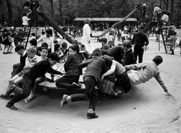 The merry-go-round (also: roundabout).  Parisian children riding merry-go-round in a playground. Alfred Eisenstaedt, 1963. I remember that the merry go round at Johnson Park was like this one.