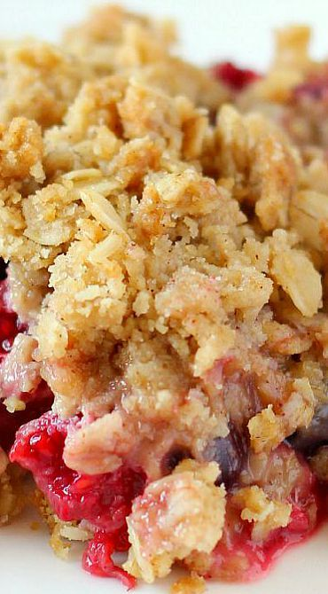 Triple Berry Crisp  Warm mixed berries topped with crispy oats makes this Triple Berry Crisp a delicious fruit dessert! Serve it with a big dollop of whip cream, vanilla ice cream or all by its self. It's delicious and a must have this summer!