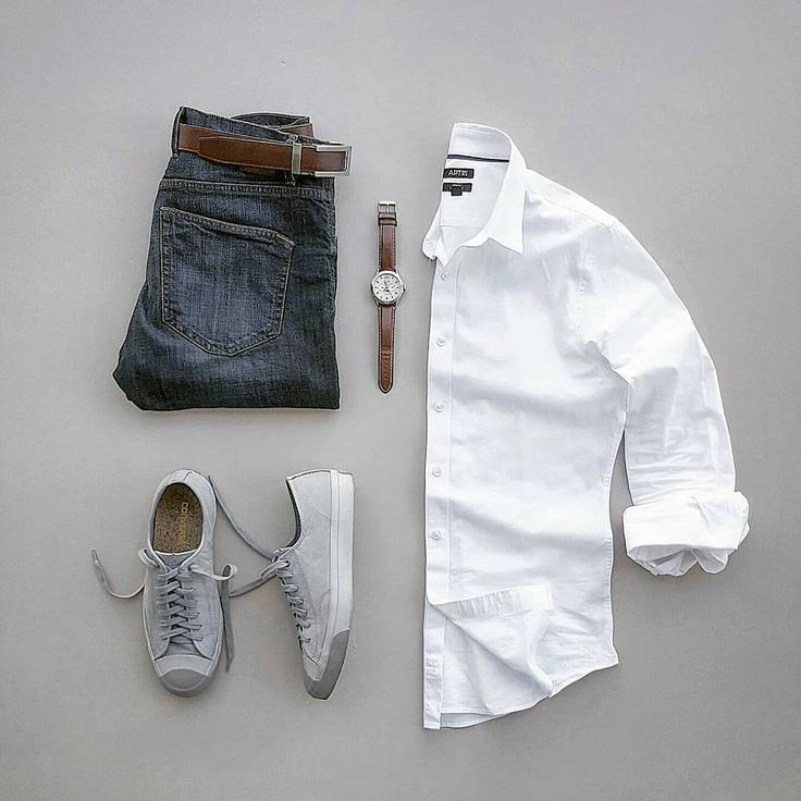 Simple and great: blue jeans, white shirt, sneakers and matching belt and watch.