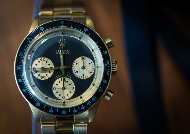 Hodinkee: A Paul Newman Daytona in solid 18k yellow gold.  Sold, and signed by Hermes.