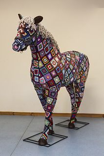 "500 4"" granny squares were made by the museum crochet group plus yards of curly braid for mane and tail. All stitched to topiary frame by me. Made to celebrate the value of horses in the hist..."