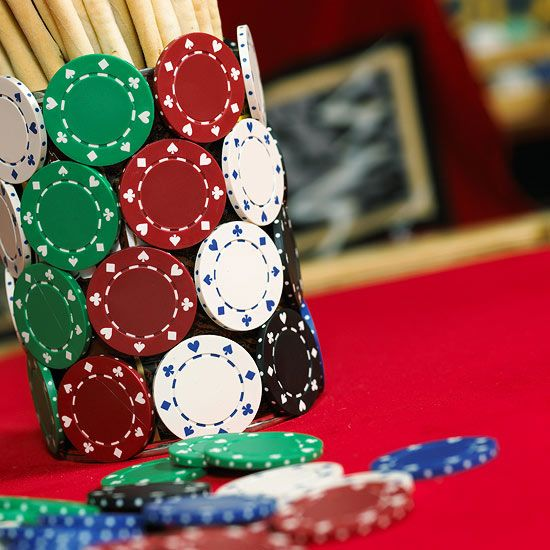 Make a poker-theme container to hold whatever you need—chips, cards, or snacks—with a few extra poker chips and a bit of hot glue. Separate your chips by color and glue them onto a plastic cup, starting at the bottom row and continuing until you've reached the top.