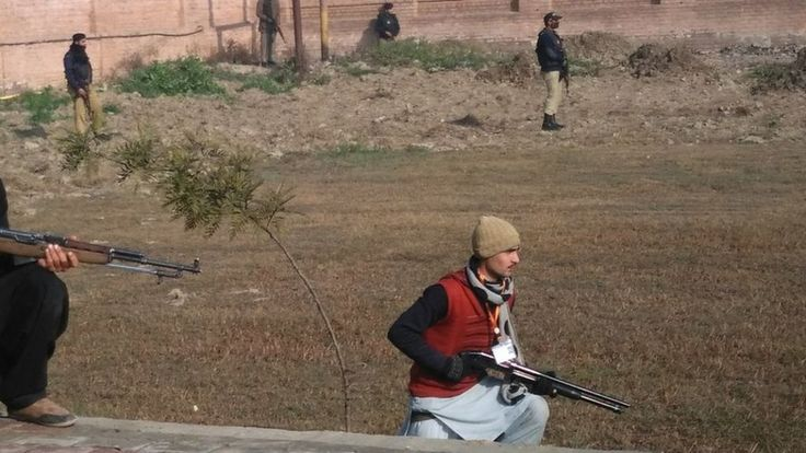 A gun attack on a university in Charsadda, north-west Pakistan, leaves at least 19 people dead, officials say.