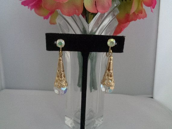 Golden Filigree Vintage French Clip Drop Dangle Earrings with Clip On Backs - Gorgeous! Priced at $23.99 before you use your coupon code 03072016 and you get 15% off your order plus free shipping to the United States. Make sure and visit our store at www.CCCsVintageJewelry.com and see over 570 items that are currently on sale in our store. Have a great vintage day! Best, Coco