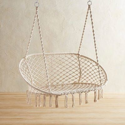 The easy-living leisure of a hammock meets the freewheeling fun of a swing in our handcrafted extra-large saucer chair. Its sturdy, wrought iron frame is dressed up with ropes that have been knotted macrame-style to form a laid-back design that can be used both indoors and out.