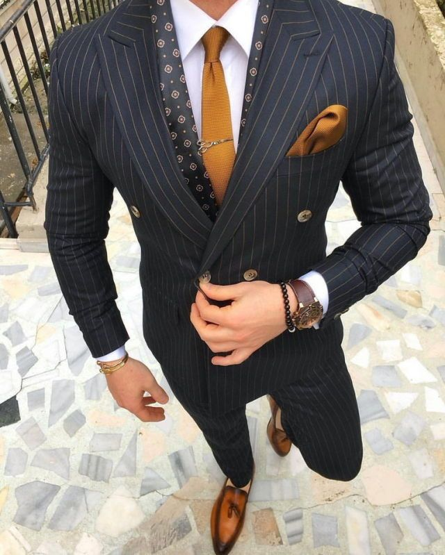 Charcoal pinstripe suit, burnt orange knit tie and pocket square