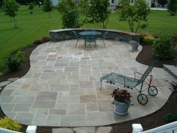 Stone Patio Ideas Backyard patio with pavers designs complete your omaha backyard with paver patios Love This The Color Of The Stone And The Varying Sizes Patio Ideas Stone Patio Designs Home Improvement Ideas