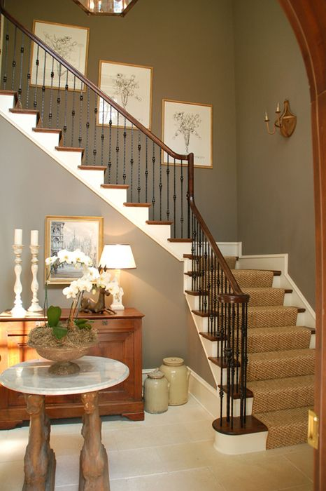 Staircase/entry by Lori Tippins. Love the mix of paint and wood, the railings, and the sisal on the stairs.
