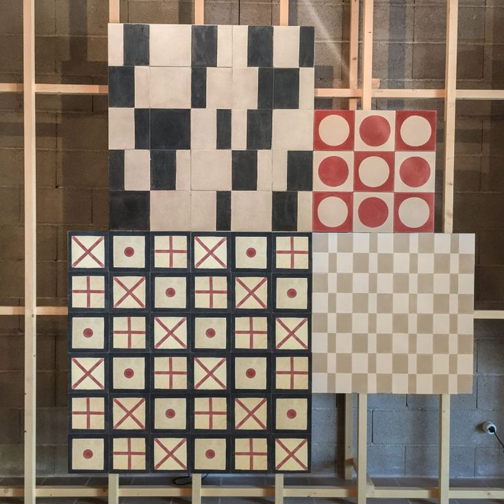 Sample boards from the Sybilla collection show six tile patterns in red, tan, and black.