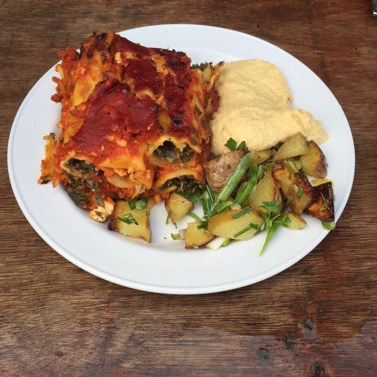 Spinach feta and sweet potato cannelloni with a rich tomato sauce and local cheddar!