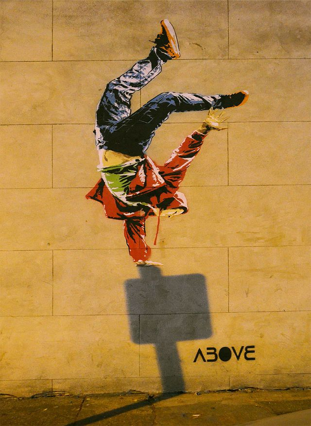 "Above ""Timing is everything"" made in the year 2013, in London. There were eight stencils used because, of the different colours used, including the stencil of the shadow."
