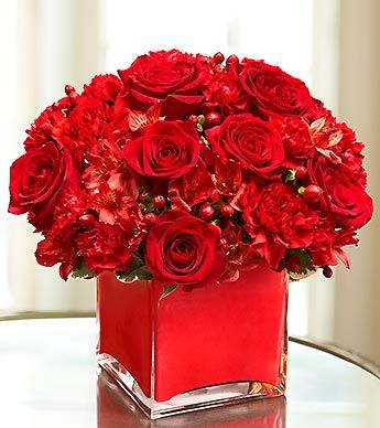 monochromatic red arrangement: bunch  as many red flowers as can find together for a spectacular effect...