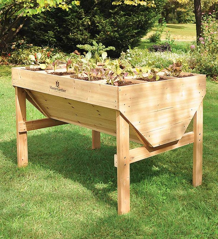 "It's easy to eat organic when you have your own garden! The 35""H Square Foot Raised Bed Gardening table keeps rabbits and garden pests away from your vegetables and the height is easy on your back and knees; it's even wheelchair accessible."