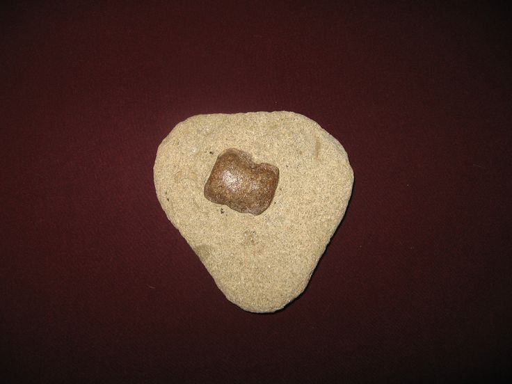 Heart_shaped rock with embedded gemstone, millions of years old, personal finding.