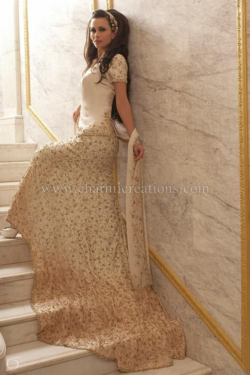The lightly embroidered ivory bodice of this indian for Indian fusion wedding dress