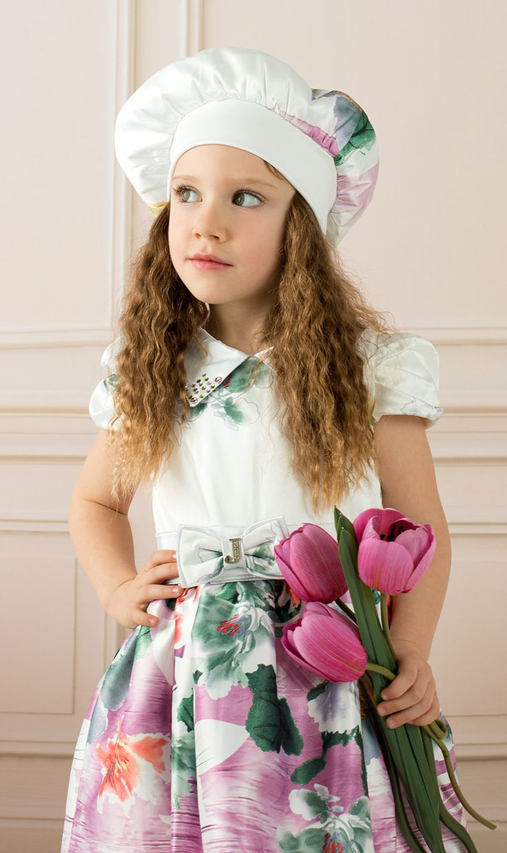 This beautiful soft satin dress  will give to your child a unique and elegant vision.