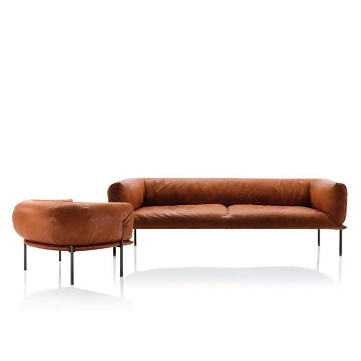 Elegant Beautiful minimal leather sofa inspired by traditional punching bags Rondo Collection by Lucy Kurrein for Molinari Living