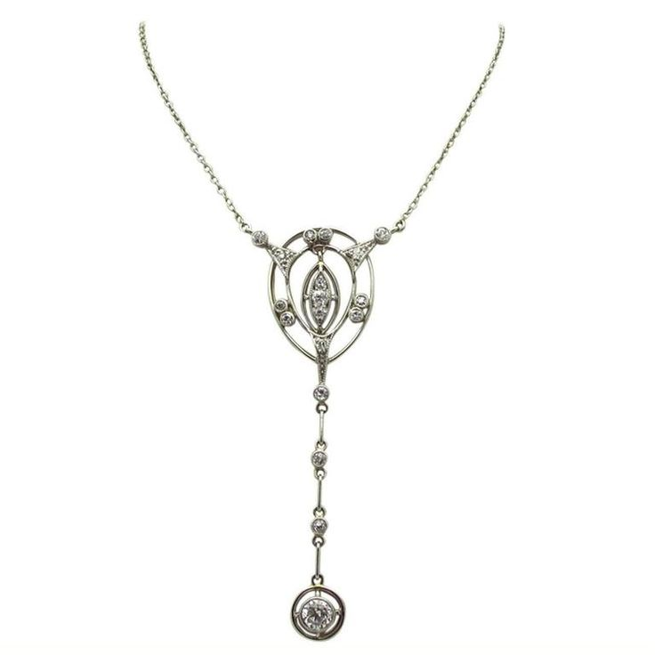 Art Deco Diamond Platinum Drop Necklace | From a unique collection of vintage drop necklaces at https://www.1stdibs.com/jewelry/necklaces/drop-necklaces/