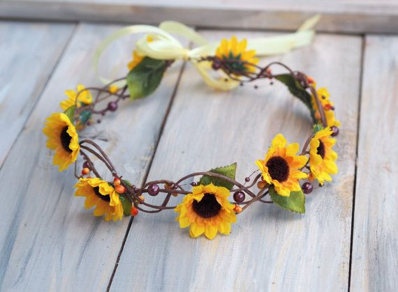 Woodland inspired hair wreath made of wired bark-covered vine, adorned with sunflowers and matching buds and wild berries which makes it look