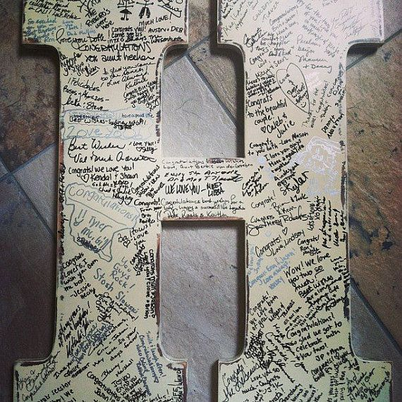 """We used an """"M"""" like this at our wedding for our guest book. LOVE IT! It now hangs above our bed. Very special!"""