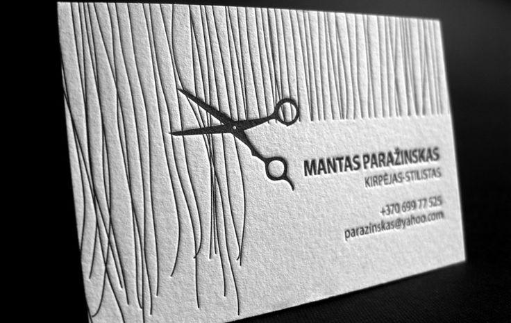 ヘアカットしてるデザインの名刺。