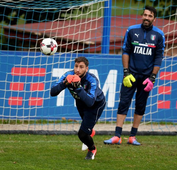 Gianluigi Donnarumma and Gianluigi Buffon (R) in action during the training session at the club's training ground at Coverciano on November 10, 2016 in Florence, Italy.