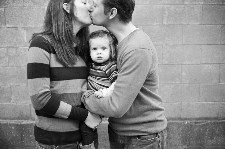 Pose for family of three - focus on child; could also do touching foreheads