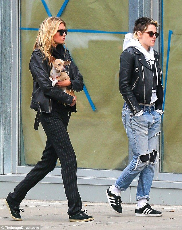 Earning her fashion stripes!The Victoria's Secret model cut an edgy figure in her loose pinstripe trousers, black sneakers, and sunglasses