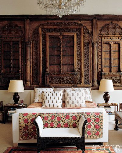 Moghul façade from a merchant's house. The bed is from the Conran Shop: Other accents include a 19th-century suzani, pillows made of cotton from India, and a European chandelier that once hung in an Indian palace.