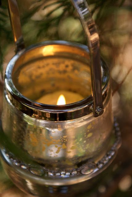 a lit votive gives a warm glow to a cold winter's day