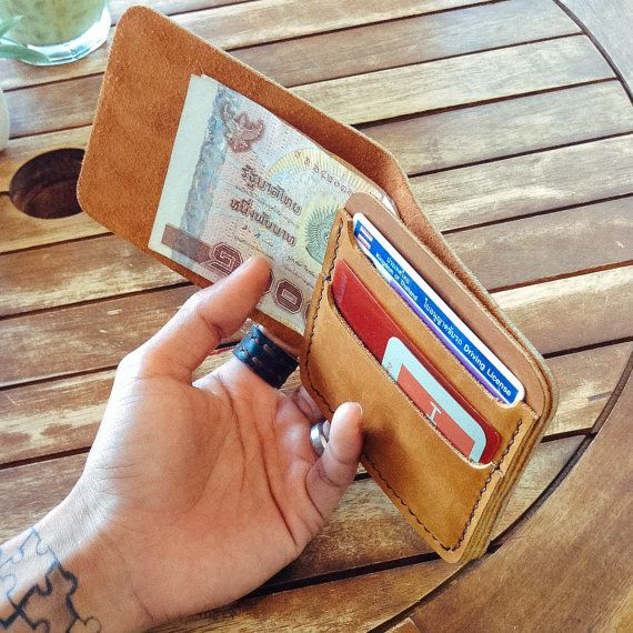 This minimal wallet made from Tan Oil leather. Handmade, hand-stitched and hand cut. It has 2 card slots and 1 slot for cash.  It is simple, minimal, unisex style and smart wallet!  Size : 8.5 cm. x 11 cm.
